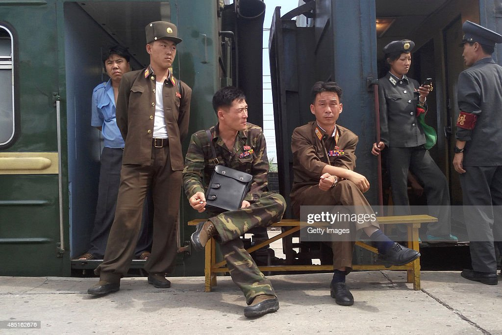 Korean People's Army soldiers take a rest at Hamhung Railway Station during a train journey amidst tension between North Korea and South Korea on August 21, 2015 in Hamhung, North Korea. North and South Korea today came to an agreement to ease tensions following an exchange of artillery fire at the demilitarized border last week.