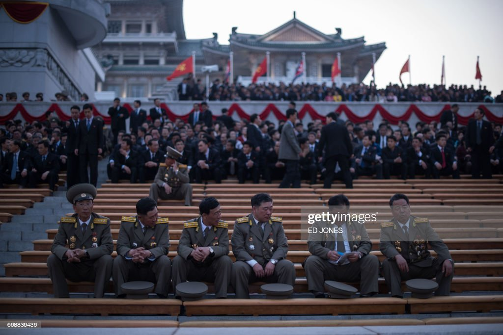 Korean People's Army (KPA) soldiers wait to watch a mass dance event marking the 105th anniversary of the birth of late North Korean leader Kim Il-Sung, in Pyongyang on April 15, 2017. /
