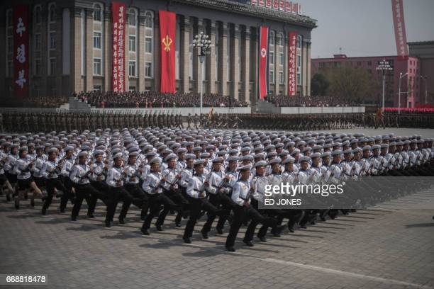 Korean People's Army soldiers watch a military parade marking the 105th anniversary of the birth of late North Korean leader Kim IlSung in Pyongyang...