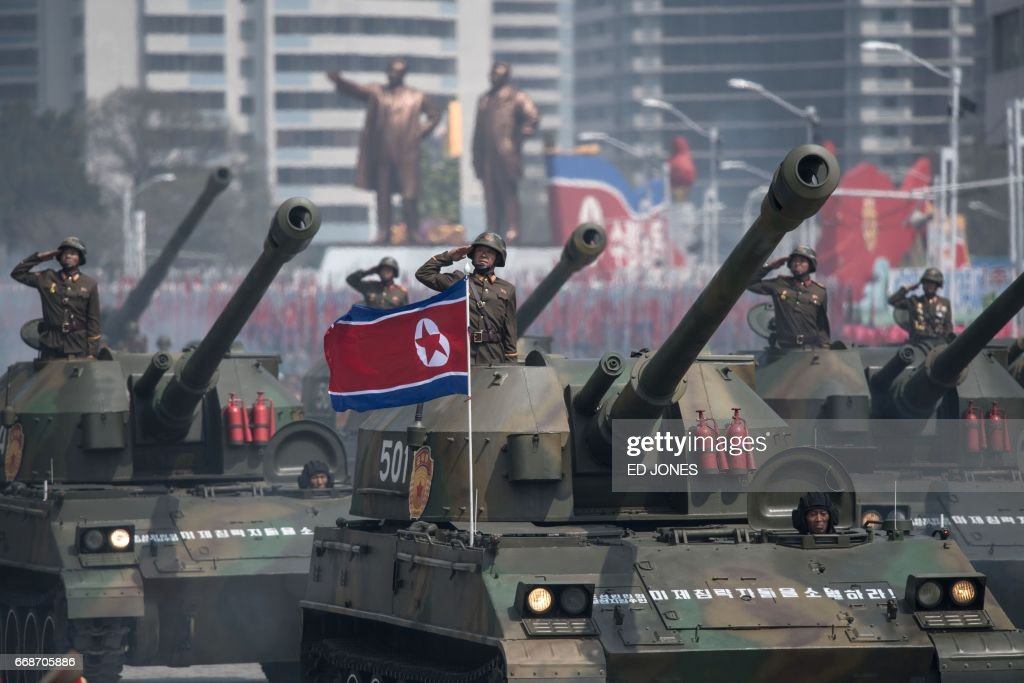 TOPSHOT - Korean People's Army (KPA) tanks are displayed during a military parade marking the 105th anniversary of the birth of late North Korean leader Kim Il-Sung in Pyongyang on April 15, 2017. North Korean leader Kim Jong-Un on April 15 saluted as ranks of goose-stepping soldiers followed by tanks and other military hardware paraded in Pyongyang for a show of strength with tensions mounting over his nuclear ambitions. / AFP PHOTO / Ed JONES
