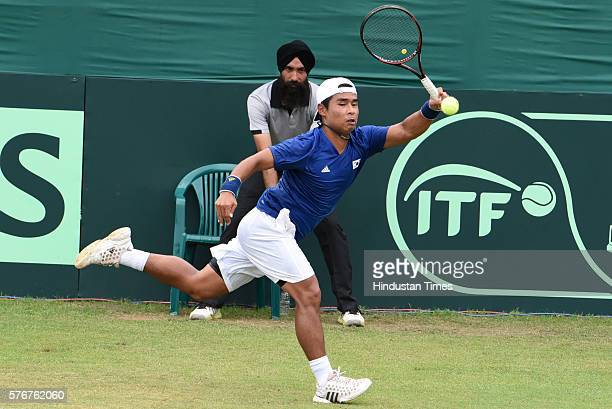 Korean player Hong Chung in action against Indian tennis player Rohan Bopanna during a Davis Cup reverse match between India and Korea at Chandigarh...