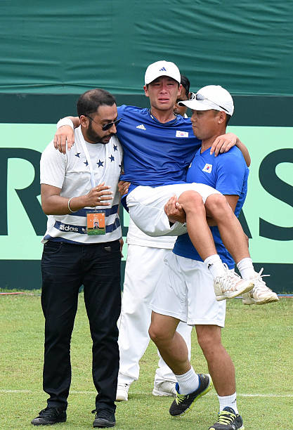Korean player Seong Chan Hong taken out of the field following injury during the match against Ramkumar Ramanathan in the Davis Cup tie between India.