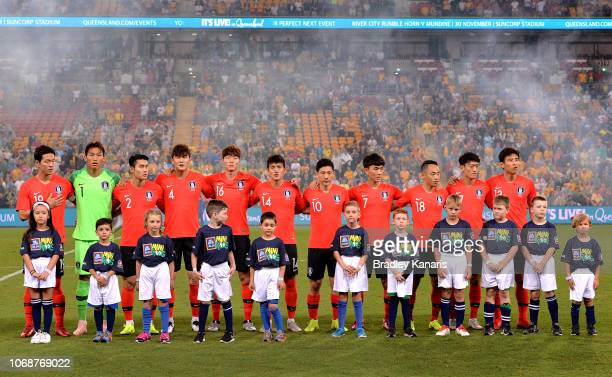 Korean players embrace during their national anthem before3 the international friendly match between the Australian Socceroos and Korea Republic at...