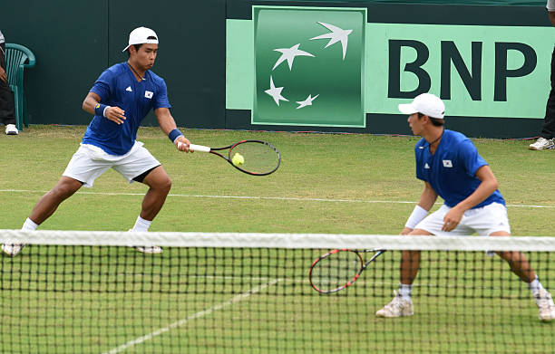 Korean players Hong Chung and Yunseong Chung in action against Indian tennis players Rohan Bopanna and Leander Paes during Doubles match at Davis Cup.