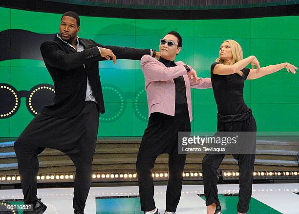 """MICHAEL 5/6/13 Korean pop sensation PSY teaches the hosts his signature dance moves from the new hit """"Gentleman""""on LIVE with Kelly and Michael..."""