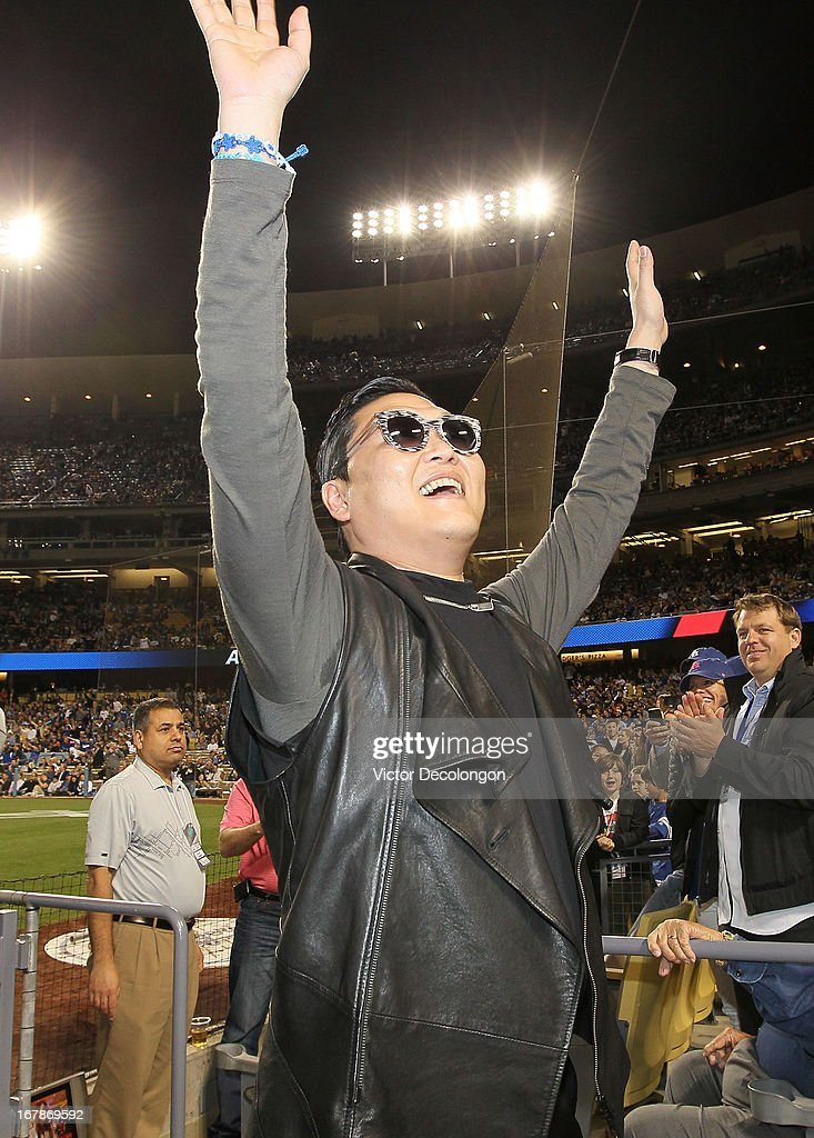 Korean Pop singer PSY makes an appearance in the fourth inning of the MLB game between the Colorado Rockies and the Los Angeles Dodgers at Dodger Stadium on April 30, 2013 in Los Angeles, California. The Dodgers defeated the Rockies 6-2.