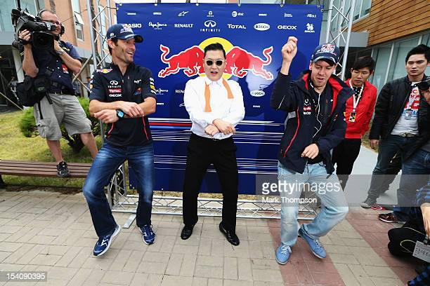 Korean rapper Psy teaches Red Bull Racing drivers Mark Webber and Sebastian Vettel the Gangnam Style dance in the paddock before the Korean Formula...