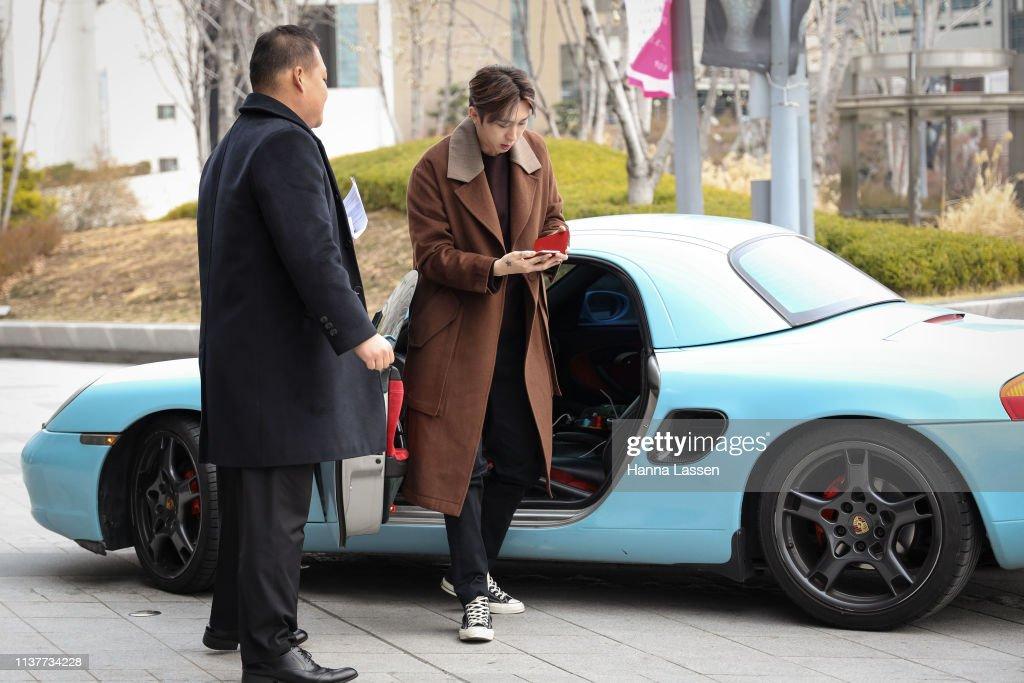 7d541d143415cc Korean rapper Sleepy wearing brown wool coat and converse shoes is ...