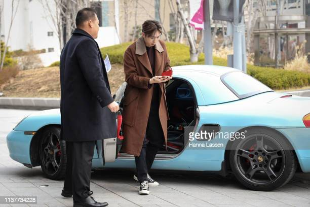 Korean rapper Sleepy wearing brown wool coat and converse shoes is seen at the Hera Seoul Fashion Week 2019 F/W at Dongdaemun Design Plaza at...