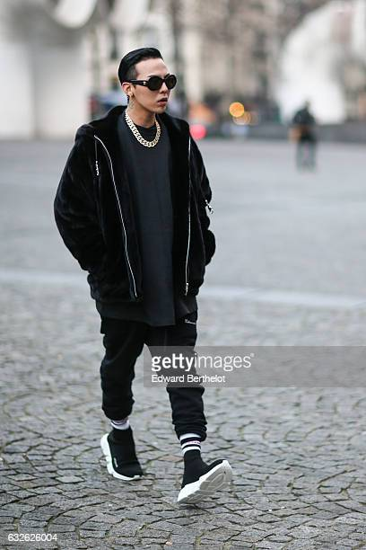Korean singer G Dragon wears sunglasses and a black jacket outside the Vetements show at Centre Pompidou during Paris Fashion Week Haute Couture...