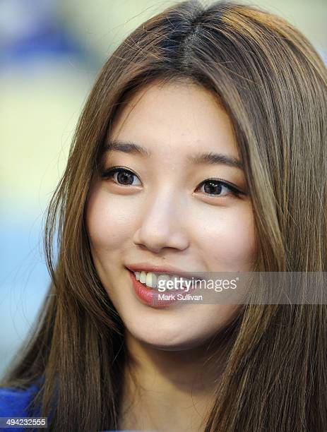 Korean singer/actress Bae Suzy aka SUZY on the field to throw out the ceremonial first pitch before the game between the Los Angeles Dodgers and...
