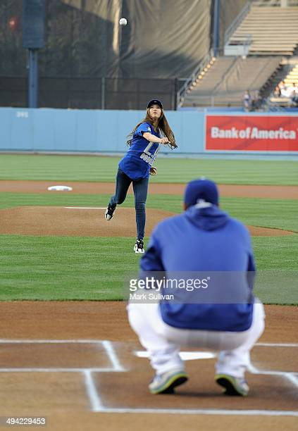 Korean singer/actress Bae Suzy aka SUZY throws out the ceremonial first pitch before the game between the Los Angeles Dodgers and Cincinnati Reds at...