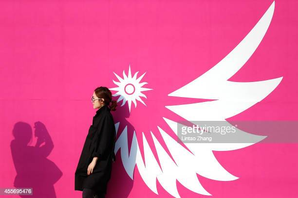 Korean spectators take a photo with the Asian Games emblem before during the Opening Ceremony of the 2014 Asian Games at Incheon Asiad Stadium on...