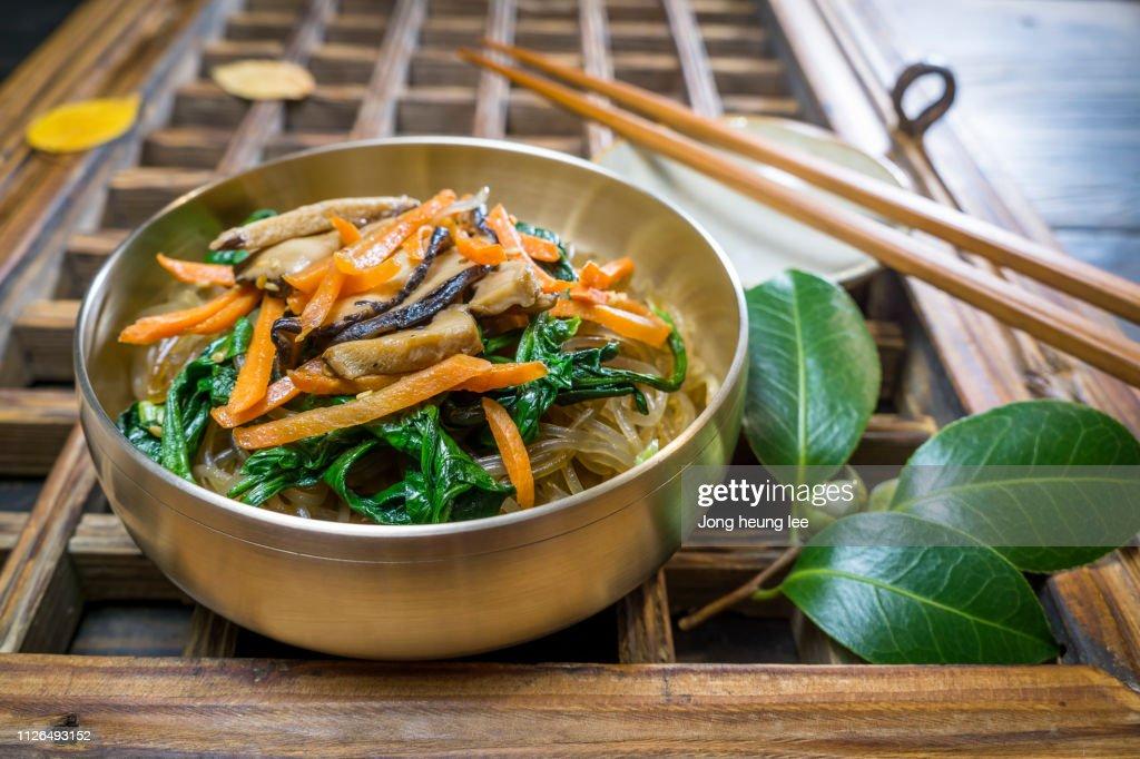 Korean stir-fried glass noodles (japchae) : Stock Photo