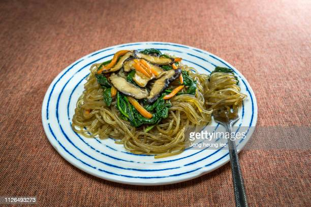 korean stir-fried glass noodles (japchae) - jong heung lee stock pictures, royalty-free photos & images