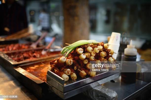 Korean street food skewers at night