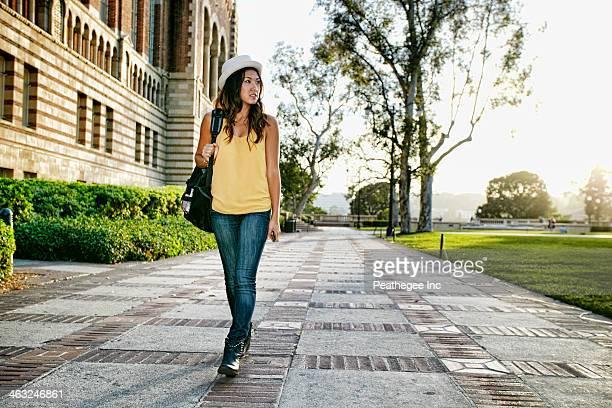 Korean student walking on campus