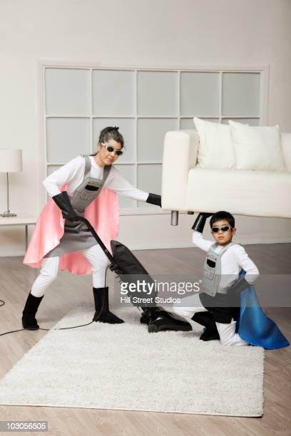 Korean superhero son lifting sofa for mother to vacuum underneath