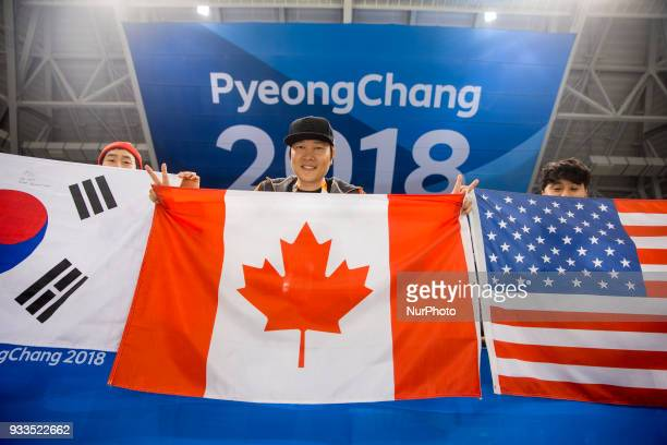 A Korean supporters shown flags of the national team during The Ice Hockey gold medal game between Canada and United States during day nine of the...