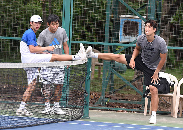 Korean Tennis players Seong Chung Yun Gaptain Ro and YongKyu Lim Davis Cup practice session at Chandigarh Club on July 14 2016 in Chandigarh India
