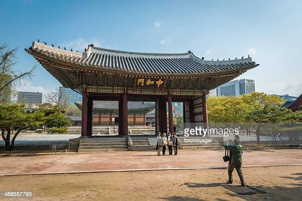 Korean tourists in the grounds of Deoksugung Palace downtown Seoul