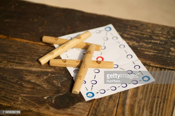 korean traditional game 'yut'. holiday background - korean culture stock pictures, royalty-free photos & images