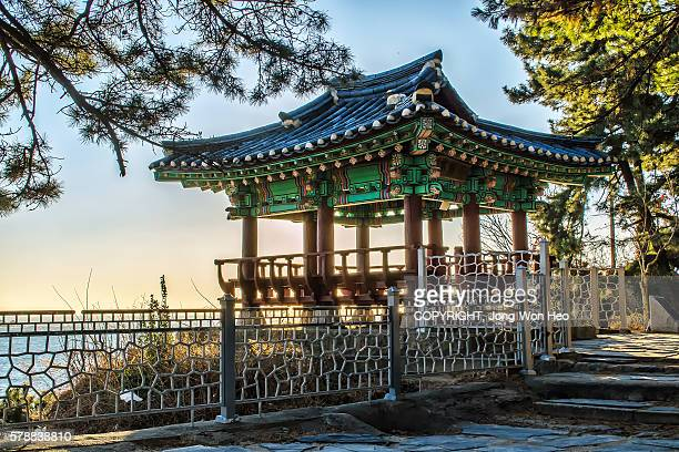 A Korean traditional gazebo on the cliff by the sea