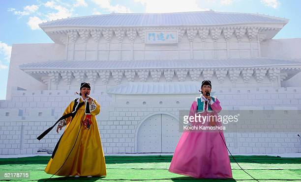 Korean traditional stage performers sing in front of the Hwaseong Fortress Janganmun or Janganmun at the Makomanai Site of The 56th Sapporo Snow...