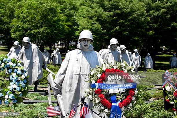 korean war memorial with floral wreaths - korean war memorial stock pictures, royalty-free photos & images