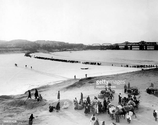 Korean War refugees flee southward across the frozen Han River in advance of Chinese and North Korean Communist forces Korea January 1951