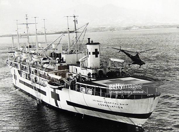The United States Naval hospital ship 'Consolation receives injured by helicopter 1952