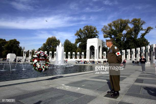 Korean War veteran Edward Bottge visits the World War II memorial on Veterans Day as he pays his respect to soldiers killed in the war November 11...