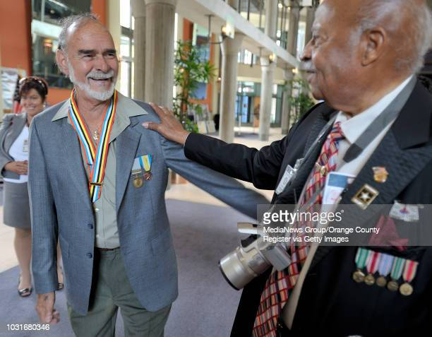 USA Korean war veterans Alfred Garcia Navy left and Larry Grant Army right compare metals after the Korean War Veterans Recognition Day in Cerritos...