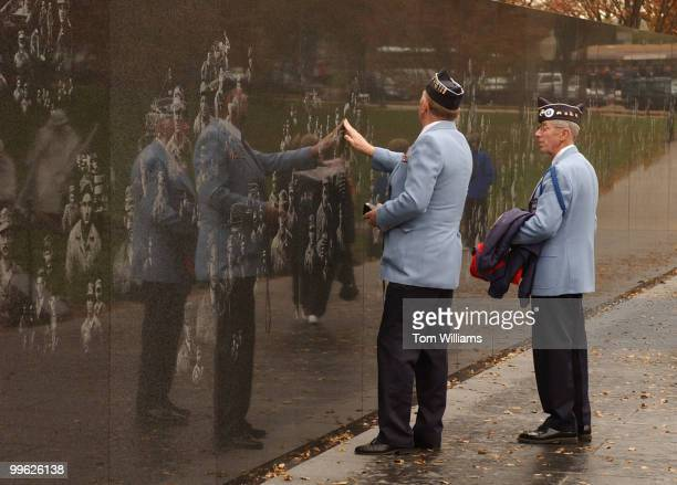 Korean War vets check out the wall of the Korean War memorial on Veteran's Day