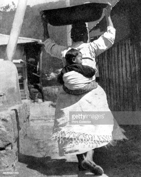 A Korean woman carrying a baby on her back 1936 From Peoples of the World in Pictures edited by Harold Wheeler published by Odhams Press Ltd