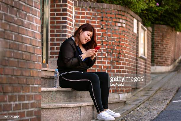 korean woman jogging at the park in seoul - hongdae - fat asian woman stock pictures, royalty-free photos & images