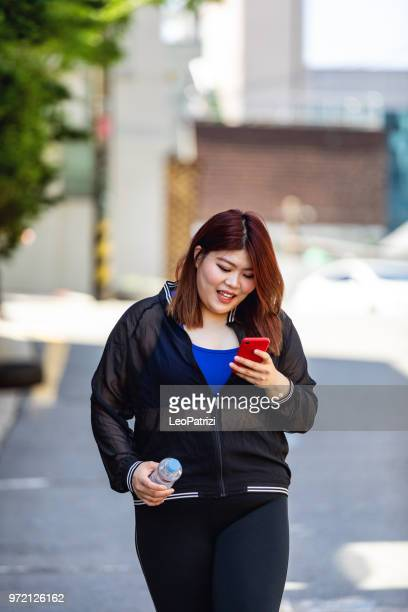 korean woman jogging at the park in seoul - hongdae - chubby asian woman stock pictures, royalty-free photos & images