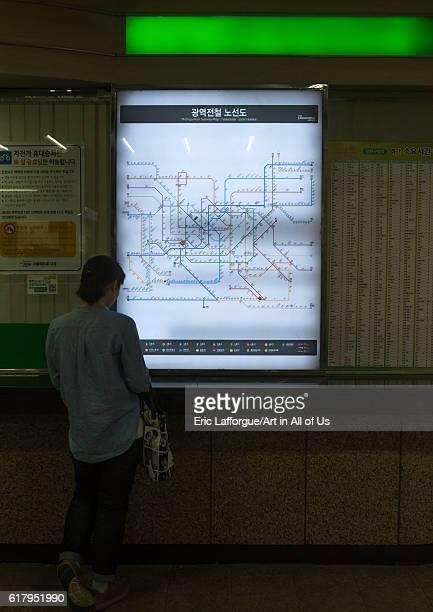 Korean woman looking at subway station map national capital area seoul South Korea on June 1 2016 in Seoul South Korea