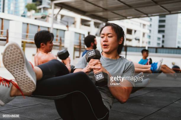 korean woman on corss training - asian six pack stock photos and pictures