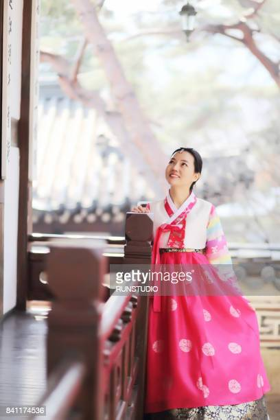 Korean woman poses in traditional clothes, Hanbok