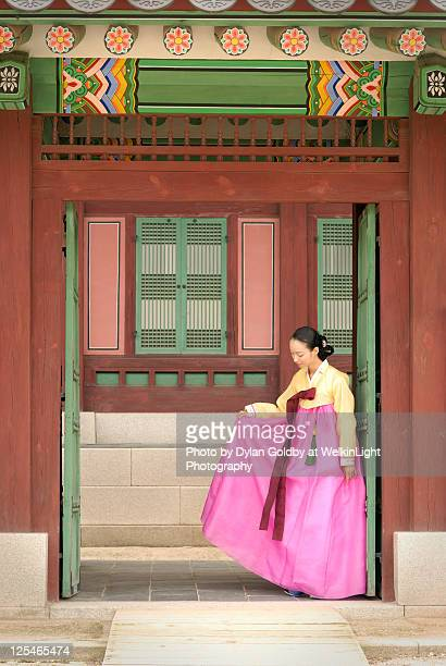Korean woman poses in traditional clothes
