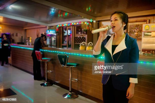 Korean woman sings a part from the movie The Lion King inside an Italian restaurant in Pyongyang 60 years after the Korean War it is clear that not...
