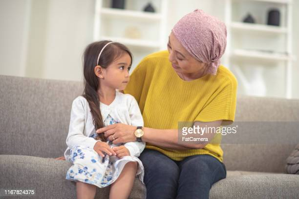 korean woman with cancer spends precious time with granddaughter - east asian ethnicity stock pictures, royalty-free photos & images