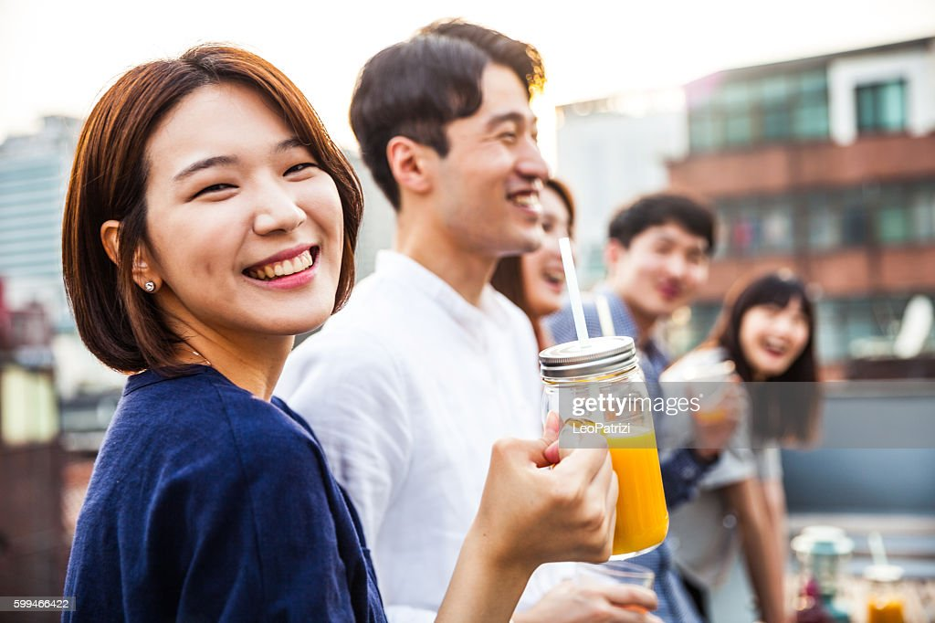 Korean woman with friends during a rooftop party in Seoul : Stock Photo