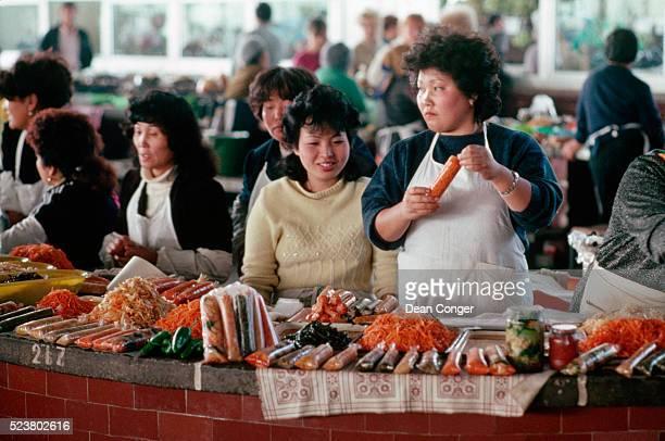 korean women at market - khabarovsk stock pictures, royalty-free photos & images