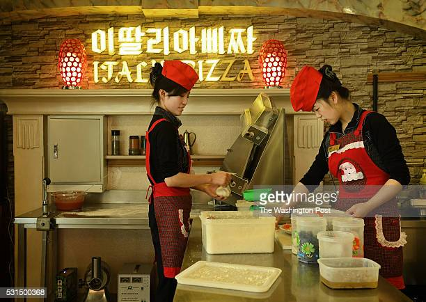 Korean women make pizzas at upscale italian pizza restaurant on Mirae Scientists Street in Pyongyang North Korea on May 7 2016