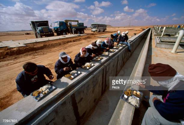 Korean workers have lunch on the construction site of the Great Man Made River in the Sahara Desert in May 2000 in Libya