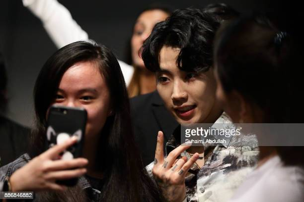 KoreanAmerican hiphop artist Jay Park one of the three judges from Asia's Got Talent Season 2 poses for a selfie with a fan after a dialogue session...