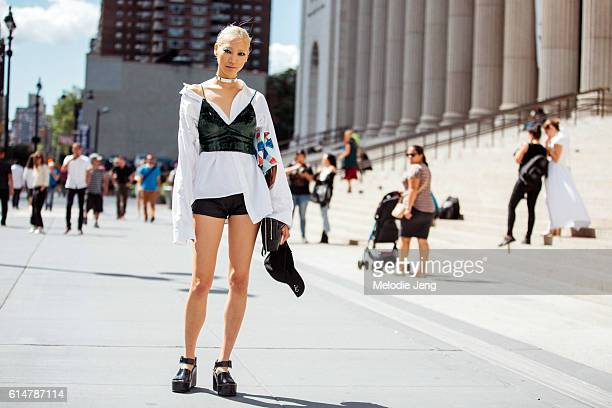 KoreanAmerican model Soo Joo wears a green velvet bra/crop top over a oversized asymetrical white shirt and Celine platform shoes after the Jeremy...