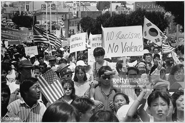 KoreanAmericans gather in Los Angeles' Koreatown in 1992 after the violent Rodney King riots to rally for peace and understanding among the city's...
